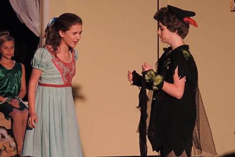 Students playing Peter Pan and Wendy at an Upstage Theatre Performance of Peter Pan